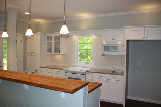 Mayo Lake Cottage kitchen butcher block counter beadboard cabinets white traditional-kitchen