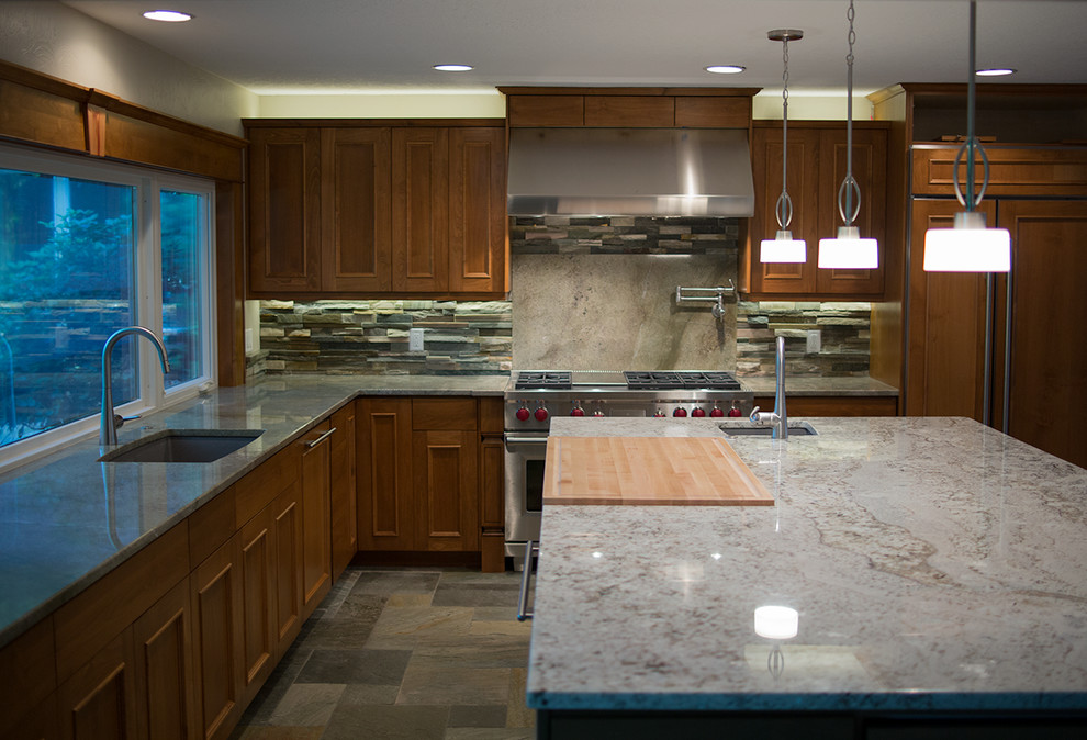 Inspiration for a large contemporary l-shaped slate floor eat-in kitchen remodel in Other with an undermount sink, flat-panel cabinets, medium tone wood cabinets, granite countertops, multicolored backsplash, stainless steel appliances and an island
