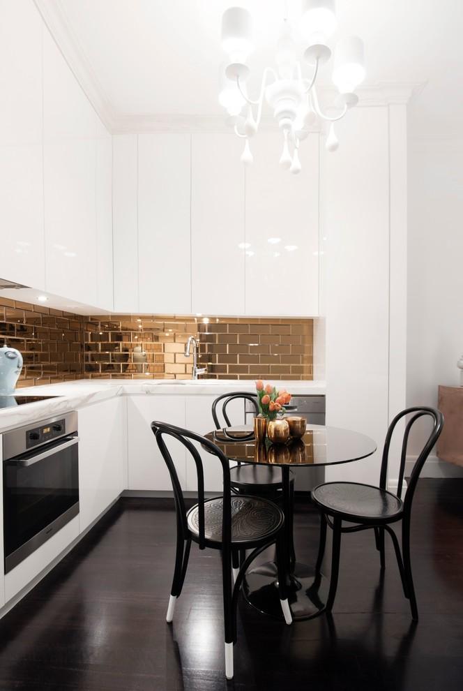 Eat-in kitchen - contemporary dark wood floor eat-in kitchen idea in Sydney with flat-panel cabinets, white cabinets, metallic backsplash and subway tile backsplash