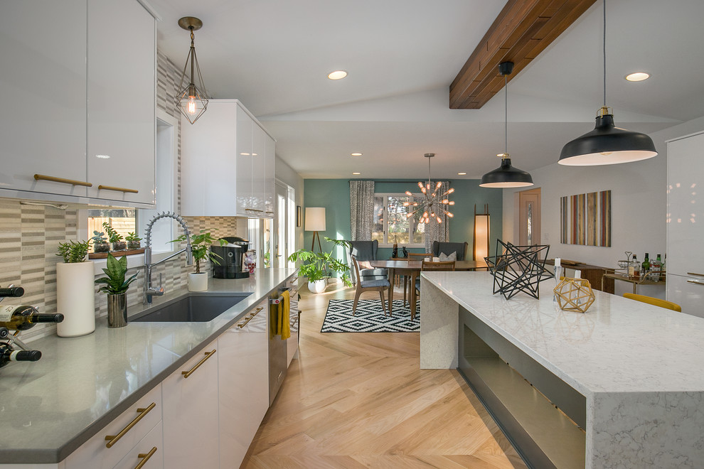 Example of a mid-century modern kitchen design in Grand Rapids