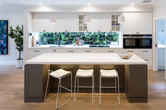 Inspiration for a transitional single-wall open plan kitchen in Melbourne with a double-bowl sink, shaker cabinets, white cabinets, window splashback, black appliances, dark hardwood floors, an island and brown floor.