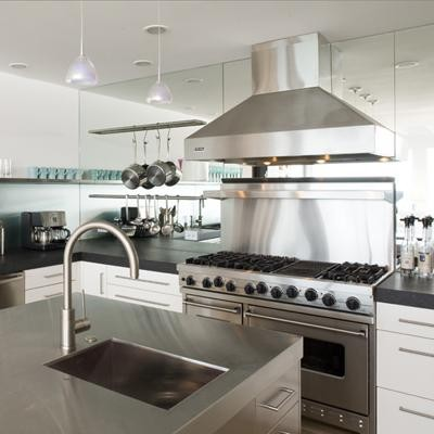Mirrored Wall. A Mirrored Wall Helps Create A Clean, Sleek Look In A Kitchen.  In The Image Above, The Kitchen Has Stainless Steel Appliances, Cabinets,  ...