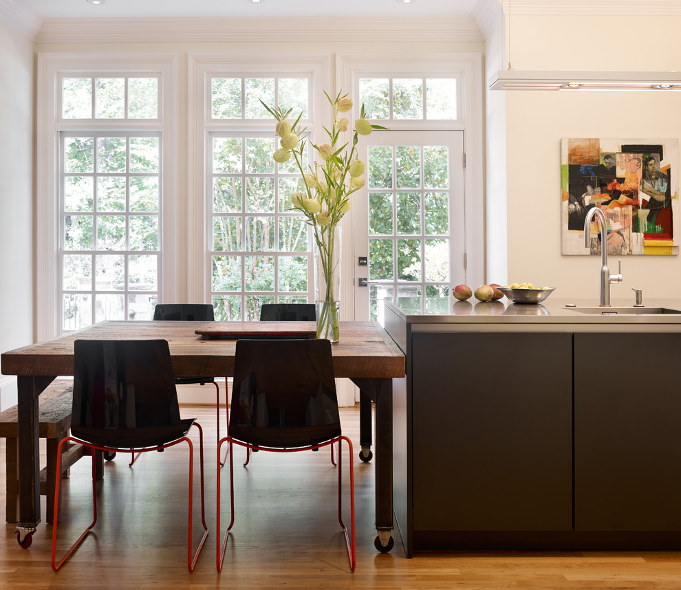 Eat-in kitchen - large contemporary l-shaped light wood floor and beige floor eat-in kitchen idea in Atlanta with an island, a single-bowl sink, shaker cabinets, white cabinets, quartz countertops, multicolored backsplash, brick backsplash, stainless steel appliances and gray countertops