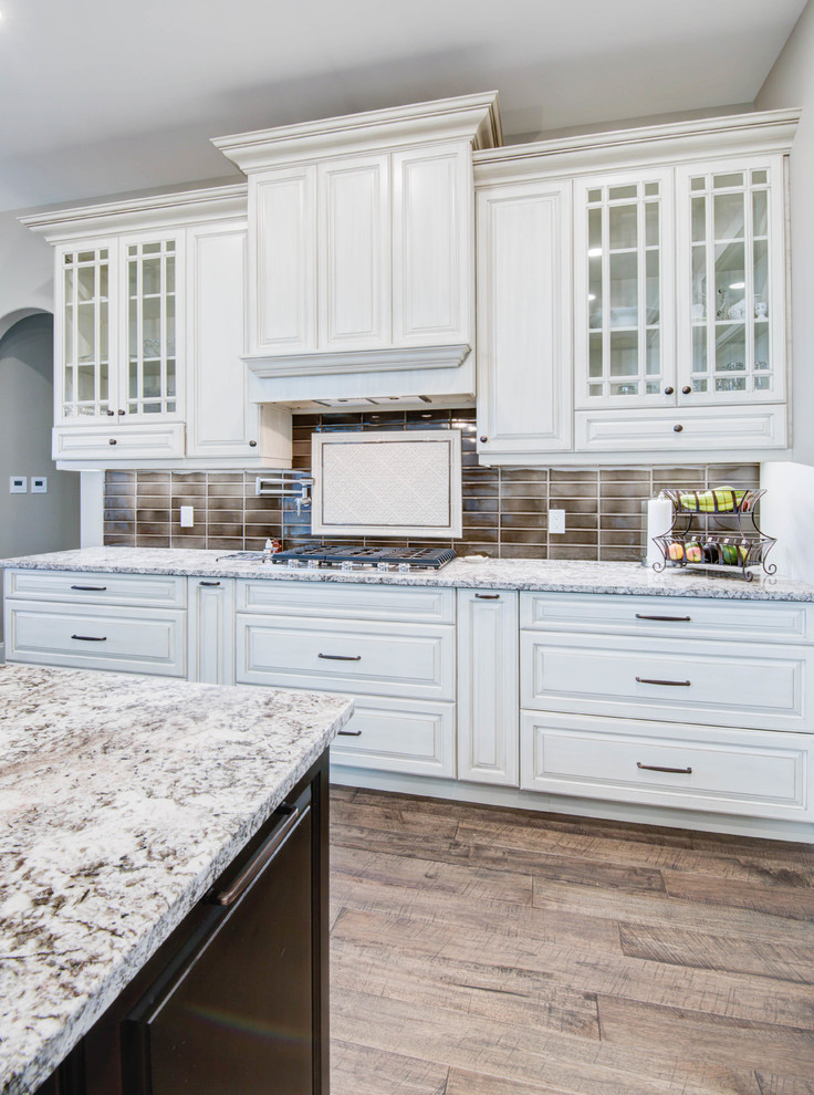 Example of a classic kitchen design in Calgary with shaker cabinets