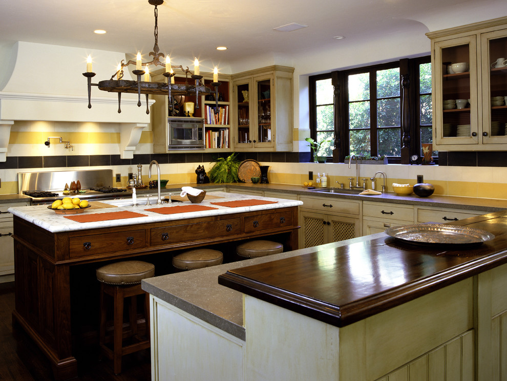 Example of a mountain style kitchen design in Los Angeles with yellow backsplash