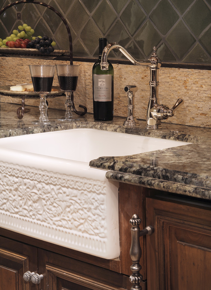 Tuscan kitchen photo in Phoenix with granite countertops, a farmhouse sink, dark wood cabinets, beige backsplash and glass tile backsplash