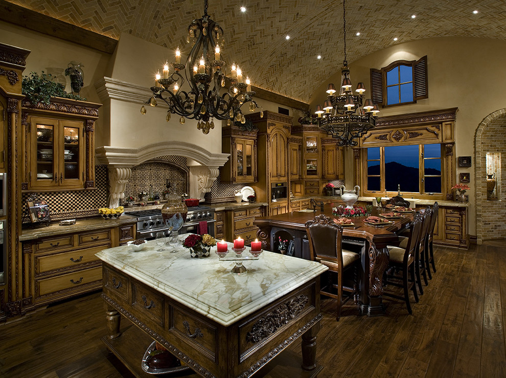 Tuscan galley dark wood floor eat-in kitchen photo in Other with a farmhouse sink, raised-panel cabinets, medium tone wood cabinets, marble countertops, multicolored backsplash, terra-cotta backsplash, paneled appliances and an island