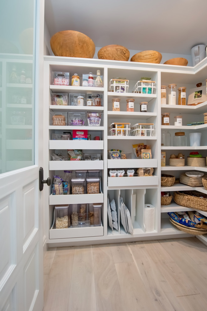 Inspiration for a mediterranean l-shaped light wood floor and beige floor kitchen pantry remodel in Orange County with open cabinets, white cabinets and no island
