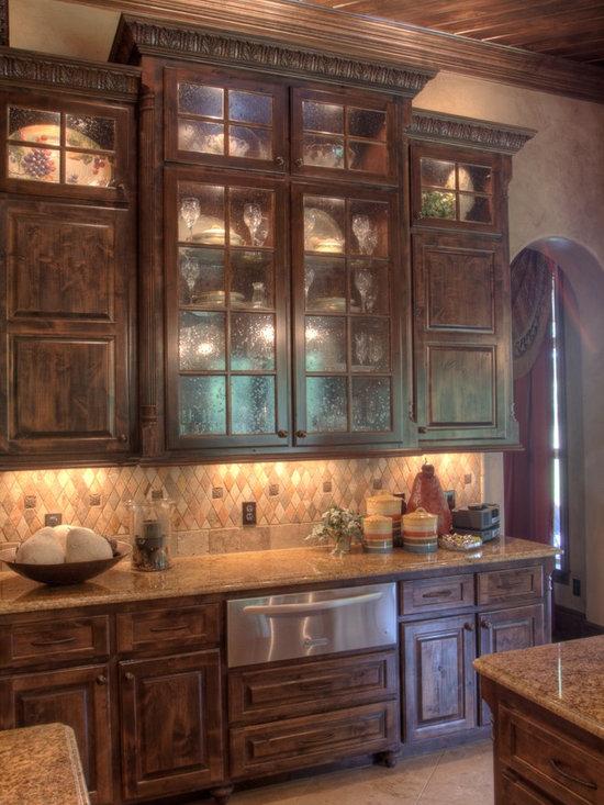 ... Mediterranean Austin Kitchen Design Photos with Glass-front Cabinets