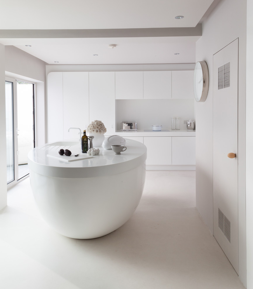 Example of a trendy kitchen design in London with flat-panel cabinets, white cabinets, white backsplash and an island
