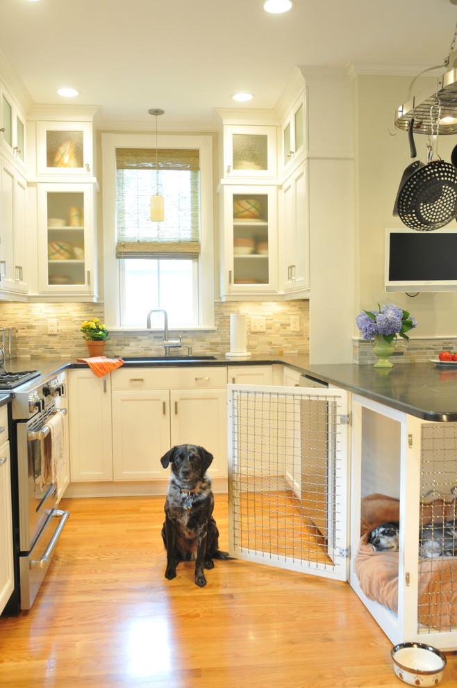 Mid-sized transitional u-shaped light wood floor and brown floor eat-in kitchen photo with an undermount sink, recessed-panel cabinets, white cabinets, gray backsplash, matchstick tile backsplash, stainless steel appliances, a peninsula, gray countertops and soapstone countertops