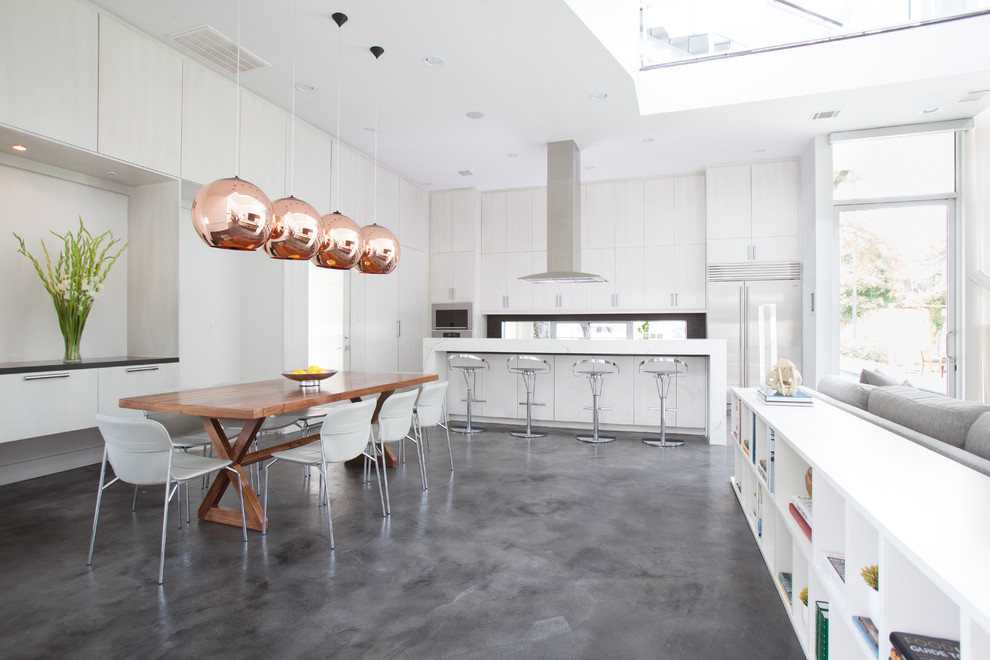 Inspiration for a contemporary gray floor eat-in kitchen remodel in Houston with flat-panel cabinets, white cabinets and stainless steel appliances