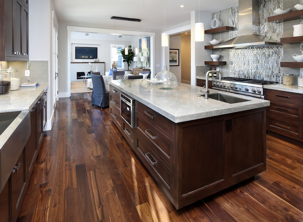 Inspiration for a large timeless galley medium tone wood floor eat-in kitchen remodel in San Francisco with a farmhouse sink, shaker cabinets, medium tone wood cabinets, quartzite countertops, gray backsplash, porcelain backsplash and stainless steel appliances