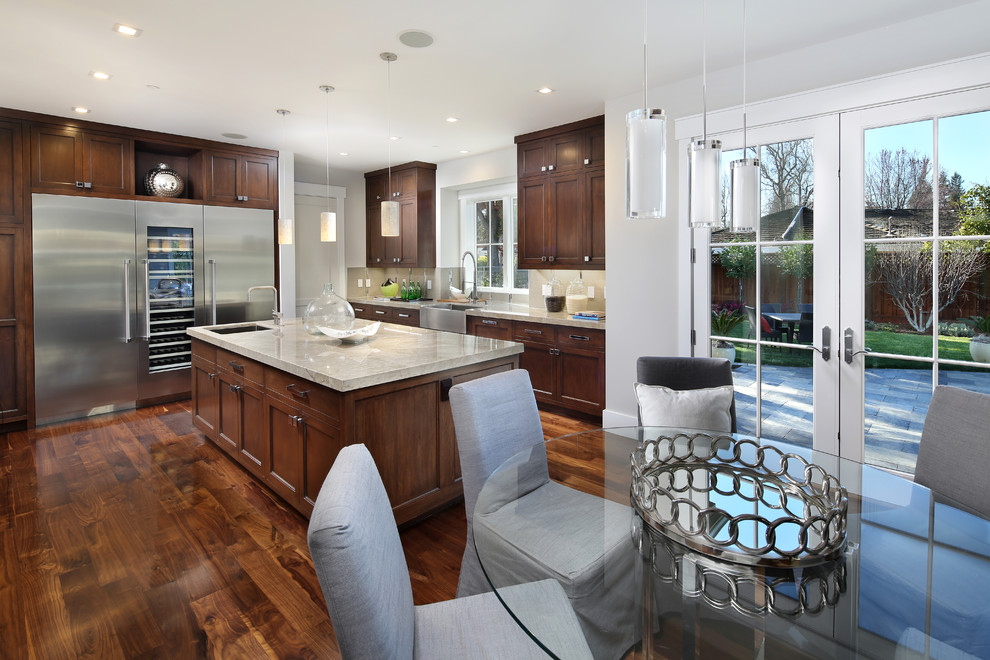 Example of a large ornate galley medium tone wood floor eat-in kitchen design in San Francisco with a farmhouse sink, shaker cabinets, medium tone wood cabinets, quartzite countertops, gray backsplash, porcelain backsplash and stainless steel appliances
