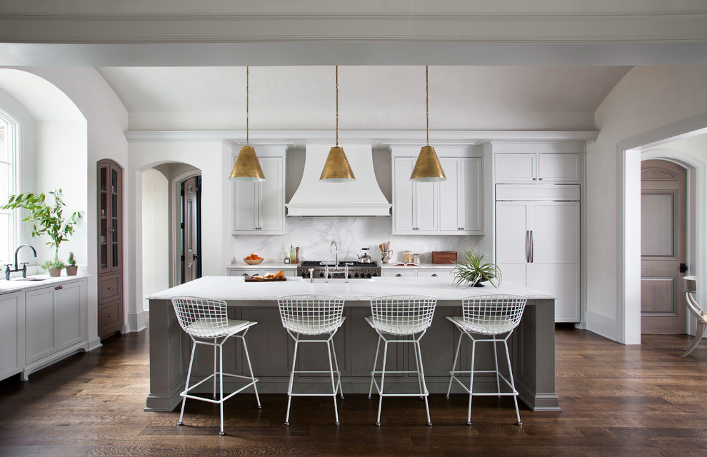 Transitional dark wood floor kitchen photo in Austin with shaker cabinets, white cabinets, white backsplash, paneled appliances and an island