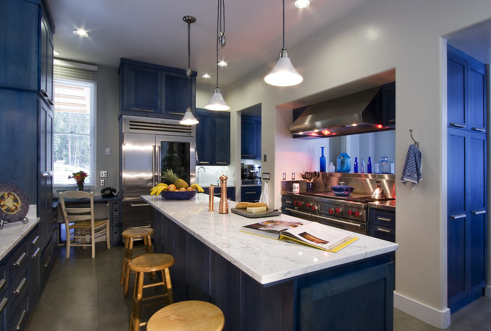 Example of a trendy kitchen design in San Luis Obispo with stainless steel appliances, shaker cabinets and blue cabinets