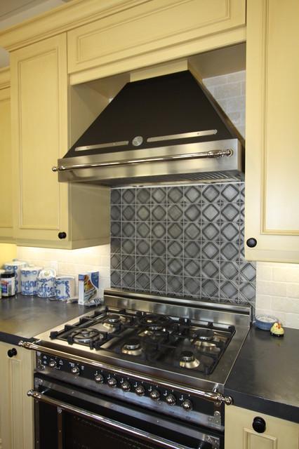 metal tiles at kitchen backsplash