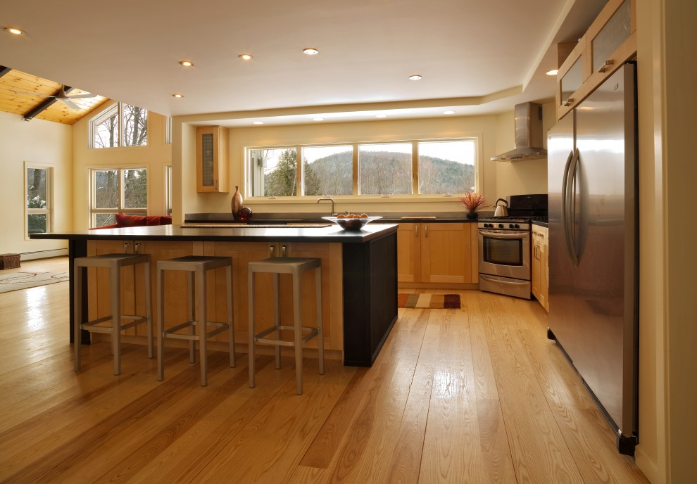 Example of a trendy kitchen design in Burlington with stainless steel appliances