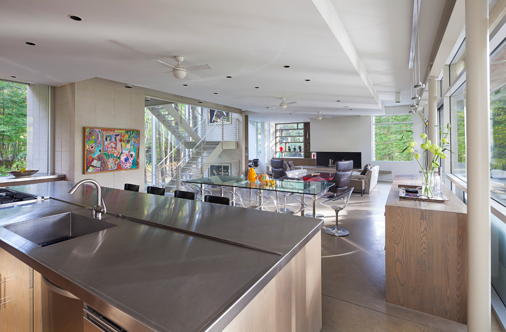 Example of a large minimalist concrete floor kitchen design in Grand Rapids