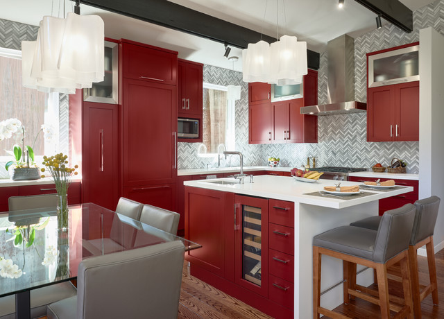 Inspiration for a contemporary l-shaped dark wood floor and brown floor eat-in kitchen remodel in San Francisco with an undermount sink, shaker cabinets, red cabinets, paneled appliances, an island and white countertops