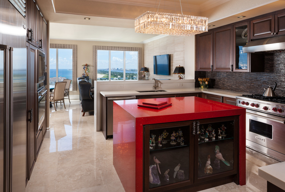 Inspiration for a mid-sized contemporary u-shaped marble floor and beige floor eat-in kitchen remodel in Miami with raised-panel cabinets, dark wood cabinets, brown backsplash, stainless steel appliances, an undermount sink, quartz countertops, an island and red countertops