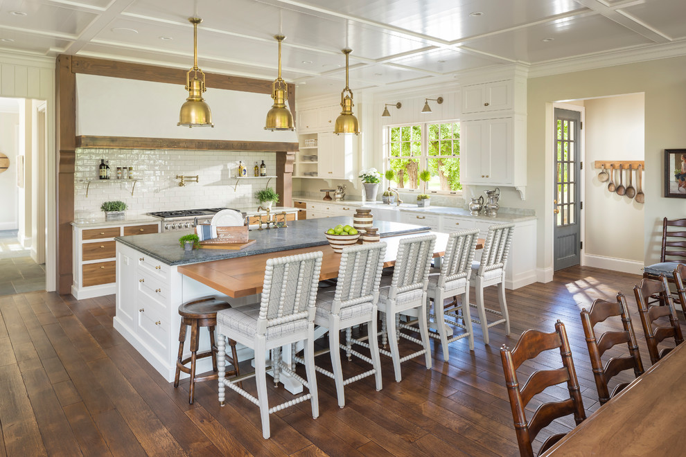 Example of a country l-shaped dark wood floor eat-in kitchen design in Salt Lake City with a farmhouse sink, shaker cabinets, white cabinets, stainless steel appliances and an island
