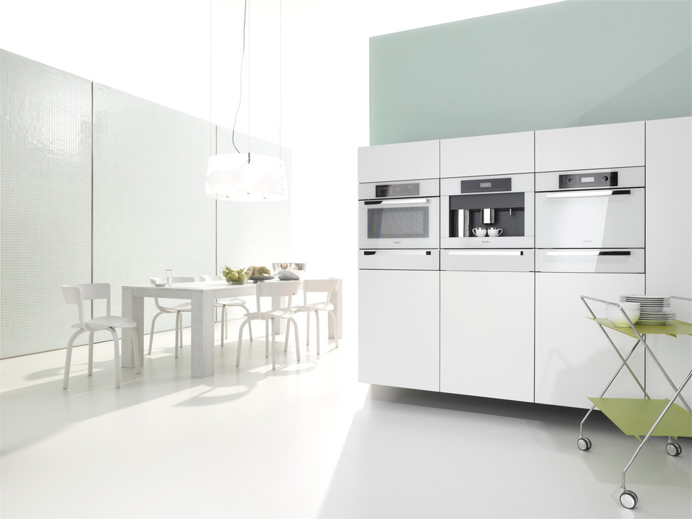 Inspiration for a contemporary eat-in kitchen remodel in Other with white appliances