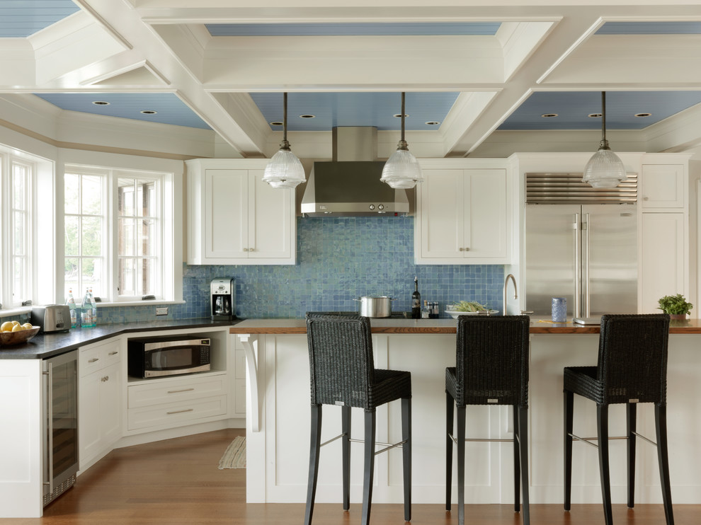 Beach style medium tone wood floor kitchen photo in Burlington with shaker cabinets, white cabinets, blue backsplash, stainless steel appliances and an island