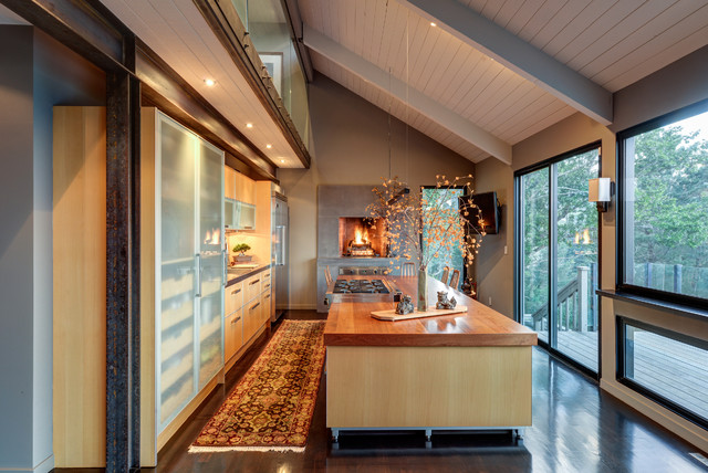 Open concept kitchen - mid-sized eclectic single-wall dark wood floor open concept kitchen idea in San Francisco with a drop-in sink, flat-panel cabinets, light wood cabinets, wood countertops, metallic backsplash and an island