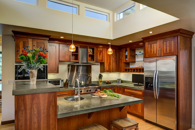 Eat-in kitchen - mid-sized craftsman l-shaped light wood floor eat-in kitchen idea in San Francisco with an undermount sink, shaker cabinets, medium tone wood cabinets, concrete countertops, stainless steel appliances and an island