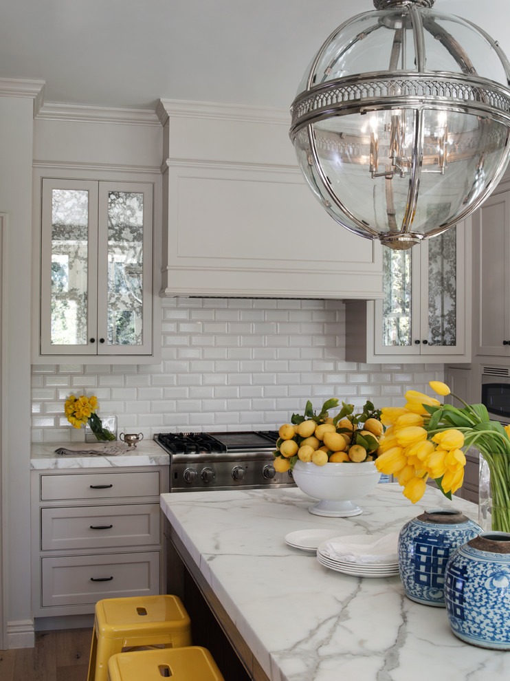 Example of an ornate kitchen design in San Francisco with marble countertops, beaded inset cabinets, gray cabinets, white backsplash and subway tile backsplash