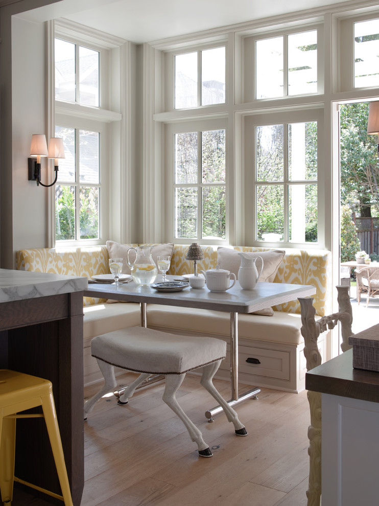 Eat-in kitchen - traditional eat-in kitchen idea in San Francisco with marble countertops