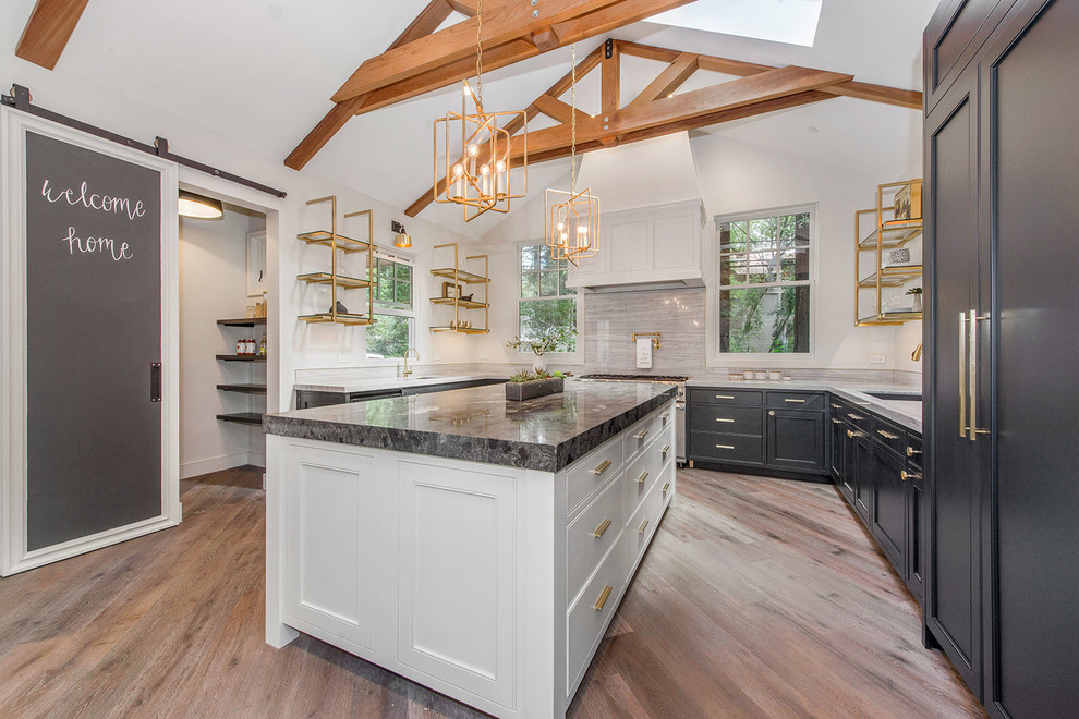 Eat-in kitchen - mid-sized transitional u-shaped beige floor and medium tone wood floor eat-in kitchen idea in San Francisco with an undermount sink, open cabinets, gray backsplash, an island, black cabinets, marble countertops, stone slab backsplash and paneled appliances