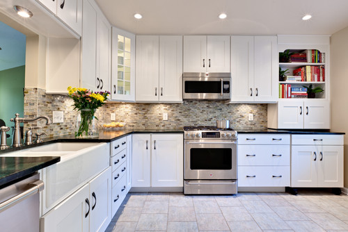 Large transitional white kitchen with pewter accents and hardware