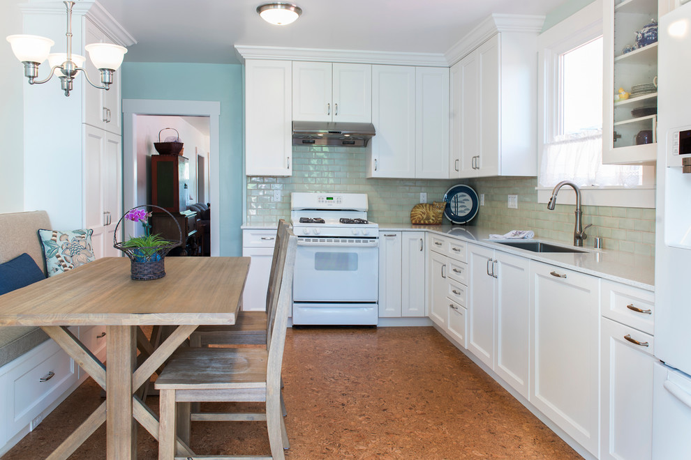 Example of a mid-sized classic l-shaped cork floor and beige floor enclosed kitchen design in San Francisco with an undermount sink, recessed-panel cabinets, white cabinets, quartz countertops, green backsplash, ceramic backsplash, white appliances and no island