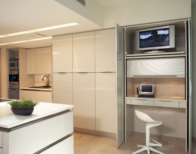 Modern kitchen idea in Miami with flat-panel cabinets