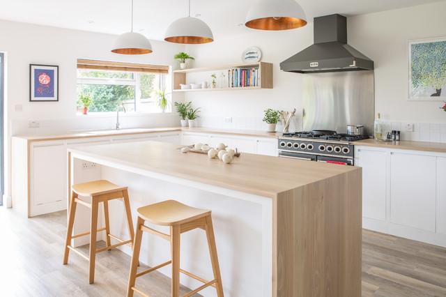 Minimalist White Kitchen with Warm Accents - Scandinavian - Kitchen ...