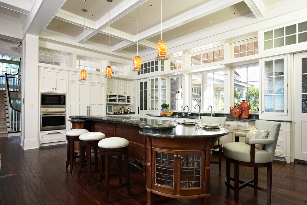 Inspiration for a victorian kitchen remodel in Minneapolis with glass-front cabinets and paneled appliances