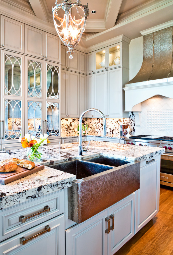 Mirrored Kitchen Cabinetry with Bronze Farmhouse Sink St ...