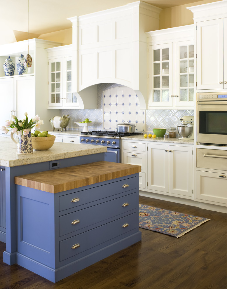 Example of a classic kitchen design in Denver with recessed-panel cabinets, colored appliances and blue cabinets