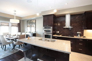Modern Kitchen And Dining Room model home kitchen and dining room combination - modern - kitchen