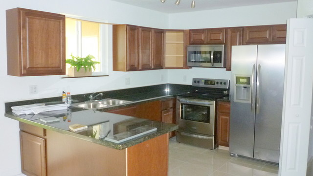 Model townhome interior design project eclectic kitchen miami