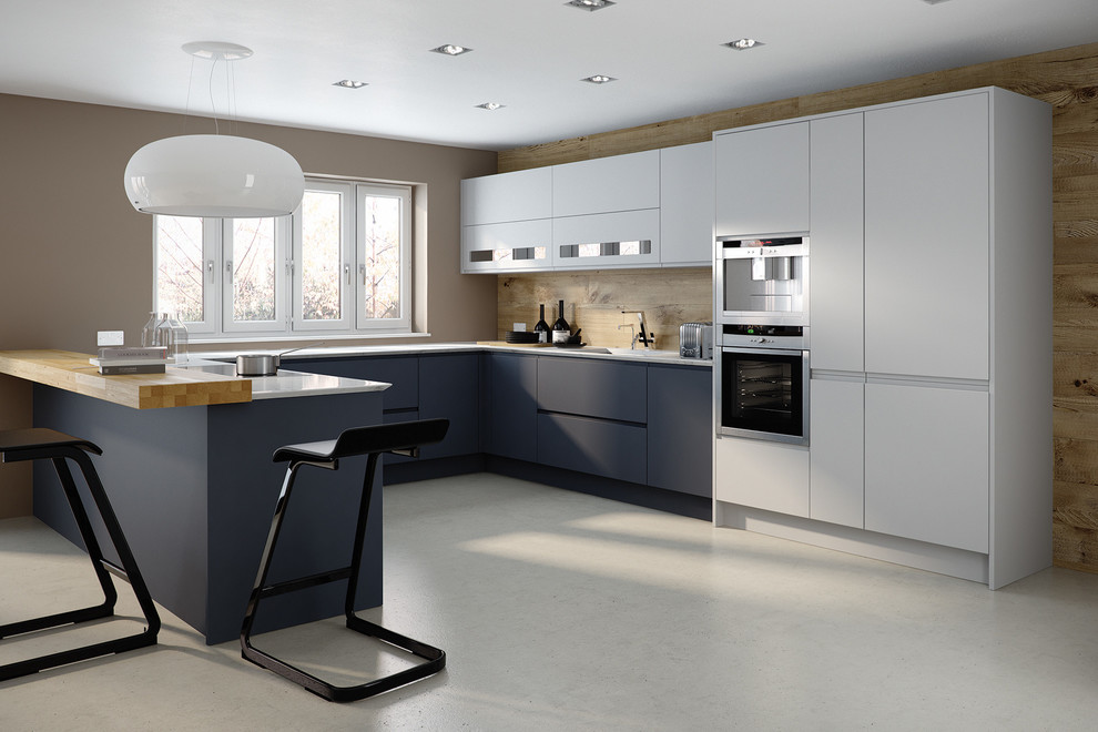 Large minimalist u-shaped eat-in kitchen photo in Other with an undermount sink, flat-panel cabinets, blue cabinets, wood backsplash, stainless steel appliances and a peninsula