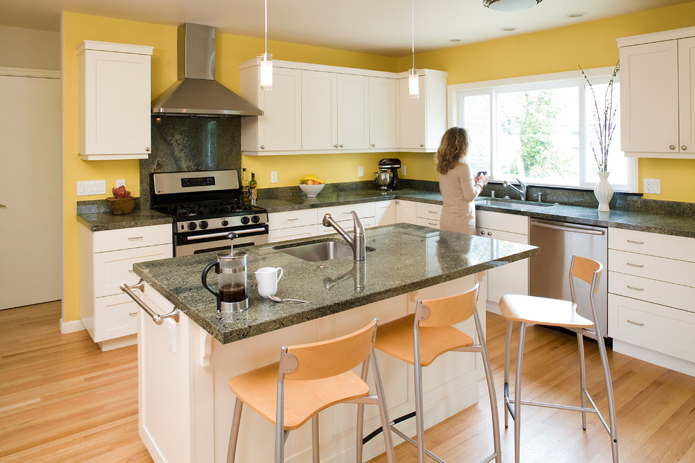 Trendy kitchen photo in San Francisco with white cabinets and green countertops