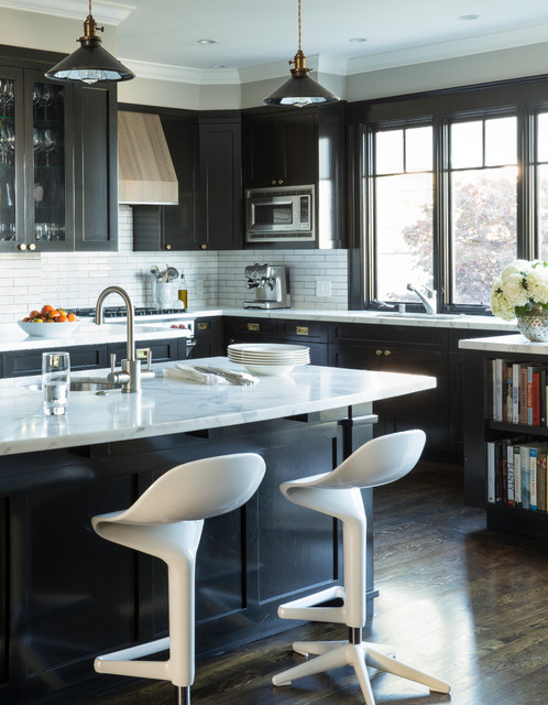 Enclosed kitchen - transitional l-shaped medium tone wood floor enclosed kitchen idea in San Francisco with shaker cabinets, dark wood cabinets, marble countertops, white backsplash, subway tile backsplash, stainless steel appliances and an island