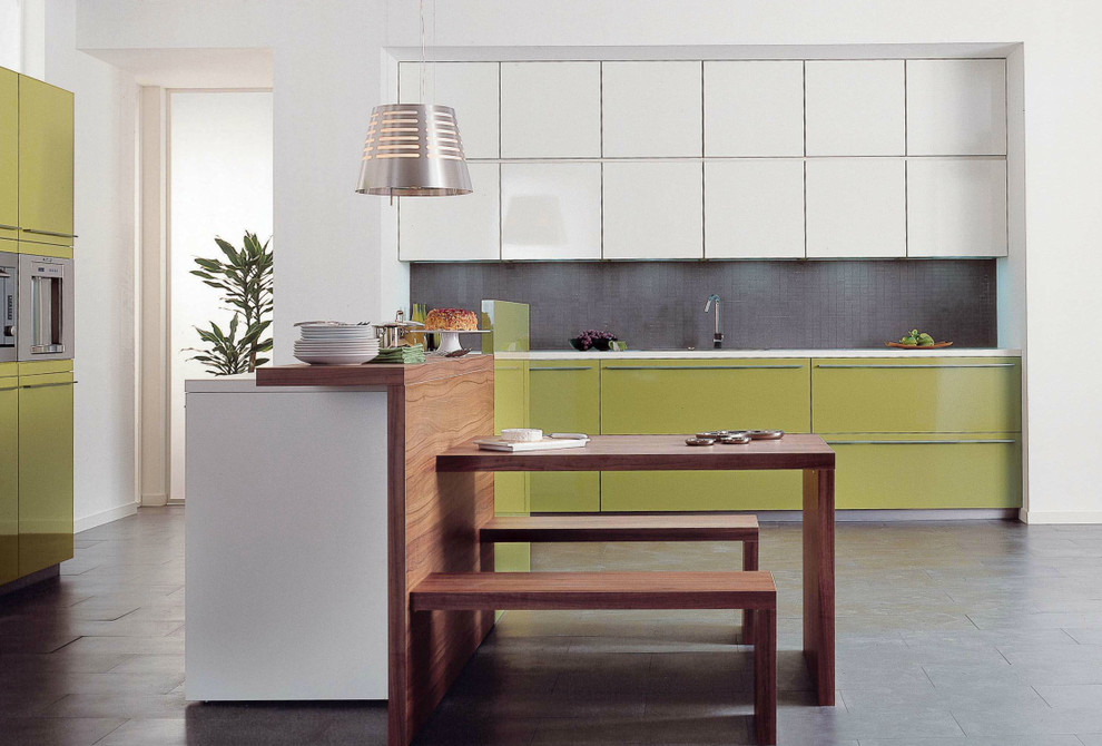 Design ideas for a medium sized modern single-wall open plan kitchen in London with a built-in sink, flat-panel cabinets, green cabinets, quartz worktops, grey splashback, mosaic tiled splashback, integrated appliances, ceramic flooring and an island.