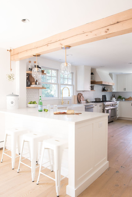 Eat-in kitchen - large farmhouse u-shaped light wood floor and brown floor eat-in kitchen idea in Boston with shaker cabinets, white cabinets, quartz countertops, white backsplash, mosaic tile backsplash, stainless steel appliances, a peninsula and white countertops