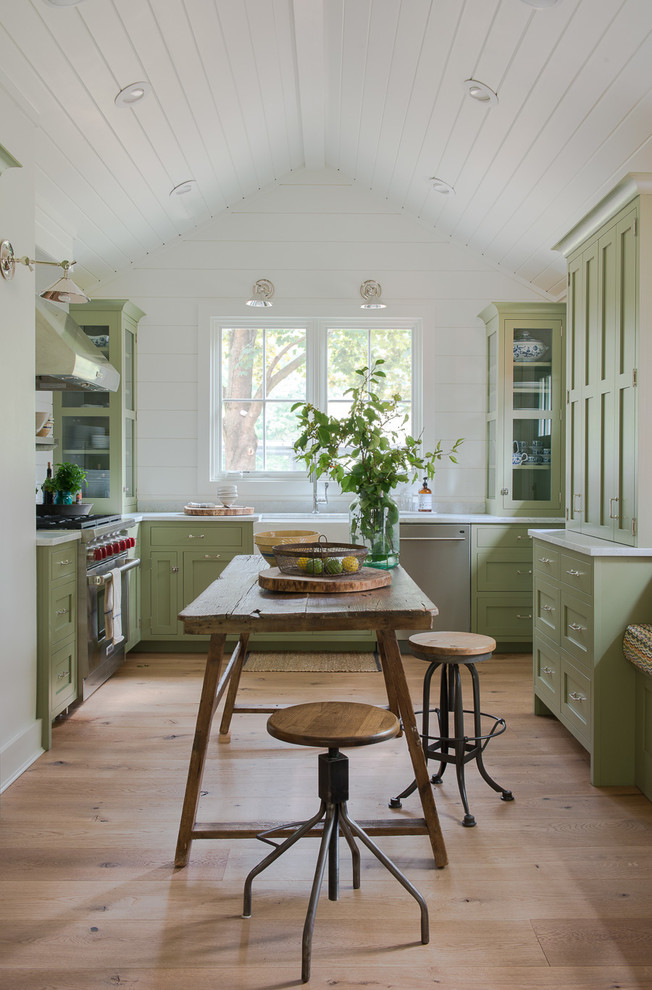 Country light wood floor kitchen photo in New York with a farmhouse sink, shaker cabinets, green cabinets, stainless steel appliances and no island