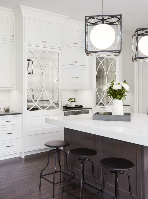 Eat-in kitchen - transitional l-shaped dark wood floor eat-in kitchen idea in Chicago with a farmhouse sink, shaker cabinets, white cabinets, gray backsplash, subway tile backsplash, stainless steel appliances and an island
