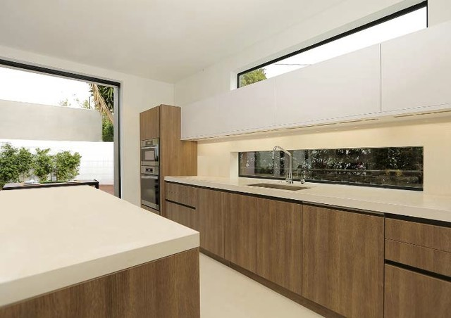Modern handle less kitchen in los angeles modern for Contemporary kitchen cabinets los angeles